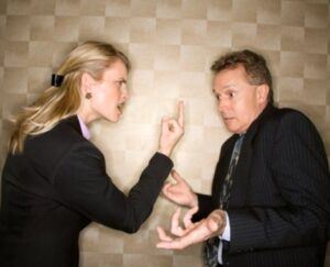 Businesswoman Flipping off Businessman